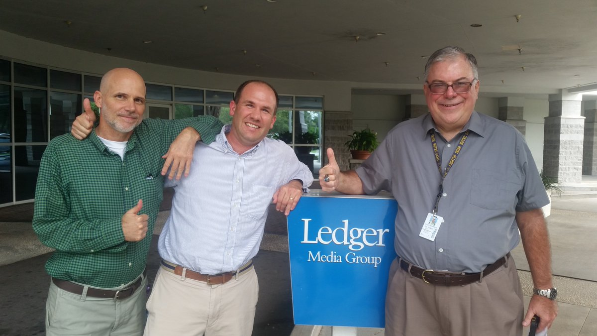 Lakeland Ledger journalists Gary White, John Chambliss & Kevin Bouffard celebrate NewsGuild victory. Photo: NewsGuild