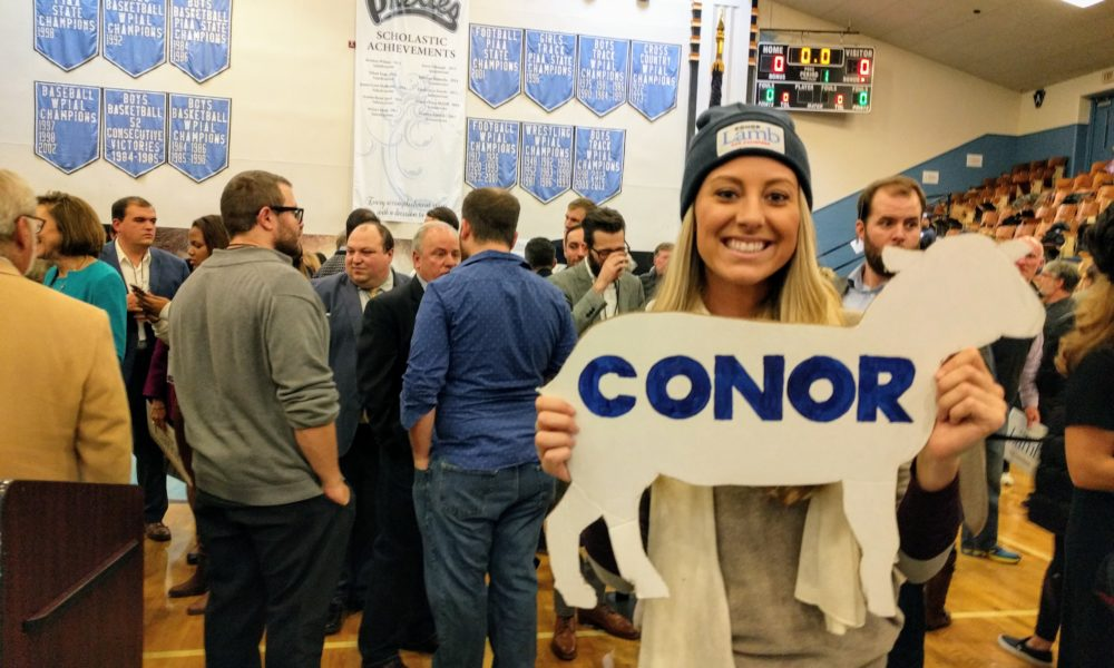 "Young female Conor Lamb supporter holding a lamb cutout with ""Conor"" inscribed on it at the nominating convention."